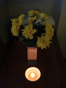 Flowers and a Floating Candle