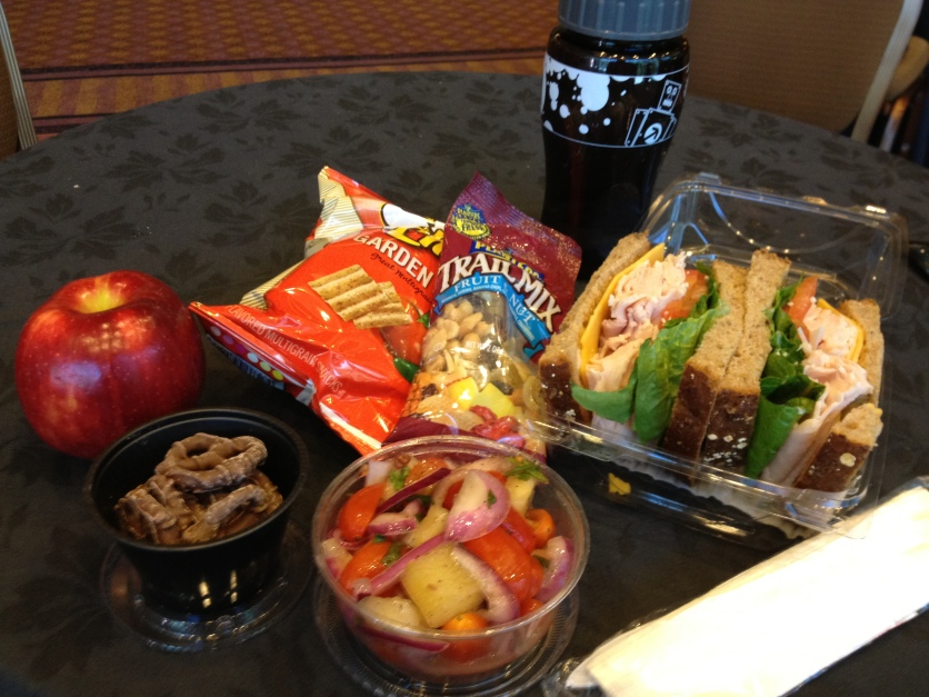 Turkey Sandwich, Tomato and Onion Salad, Chocolate Pretzels, Apple, Snacks