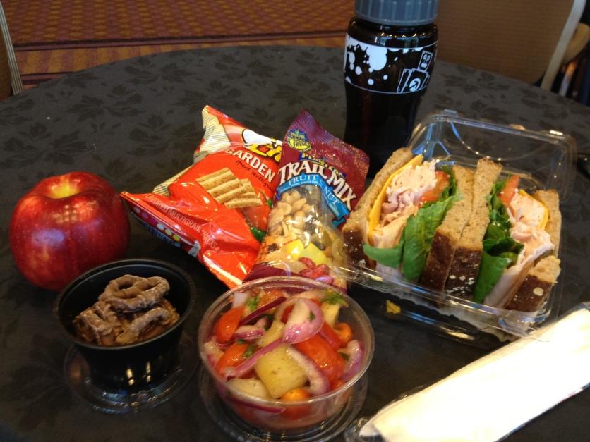 Turkey Sandwich, Tomato and Onion Salad, Chocolate Pretzels, Apple, Snacks