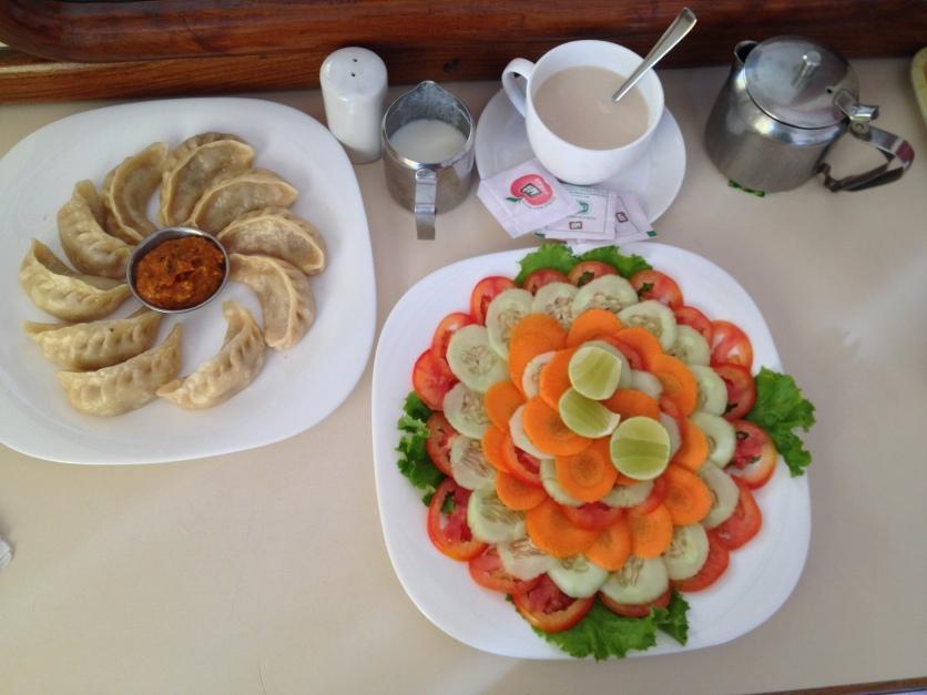 """Steamed Chicken Momos, Hot Milk Tea, """"Green"""" Salad"""